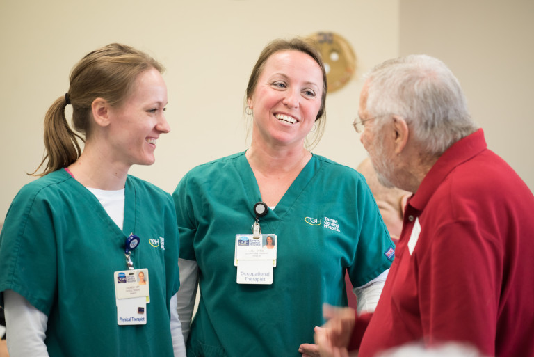 Physical Therapist Lauren Lindiakos, left, and occupational therapist Lisa Clark talk to former patient Fred Plumb at the Rehabilitation Reunion.