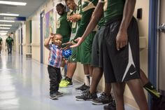 Patient high-fiving USF football players