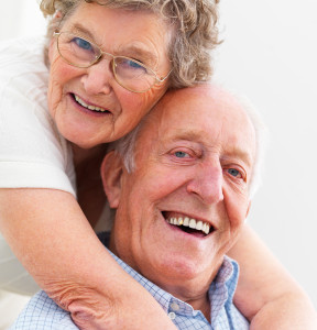 Elderly couple smiles