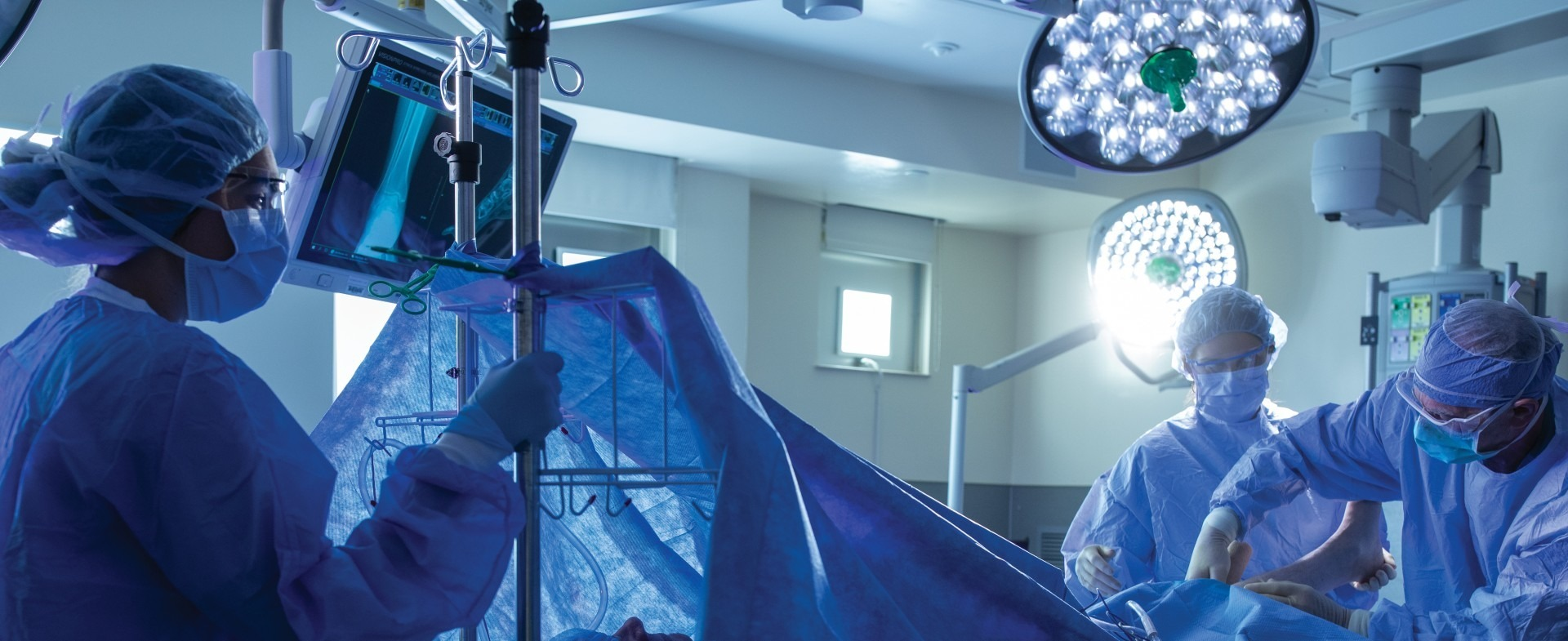three TGH orthopedic surgeons performing a surgery
