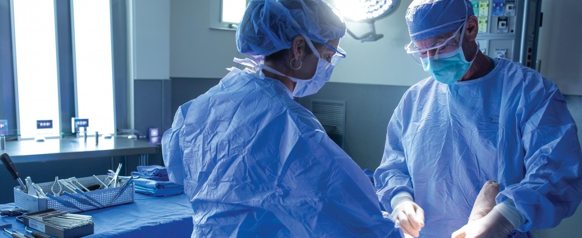 two TGH Orthopedic surgeons performing surgery