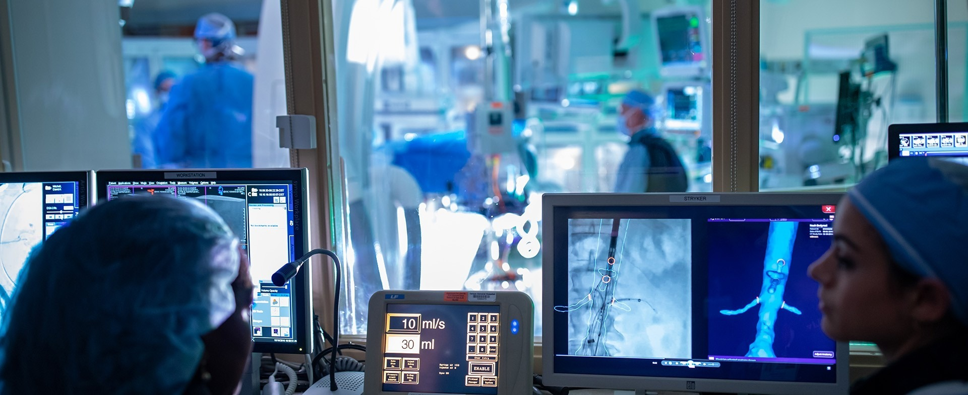 Medical team monitoring a surgery