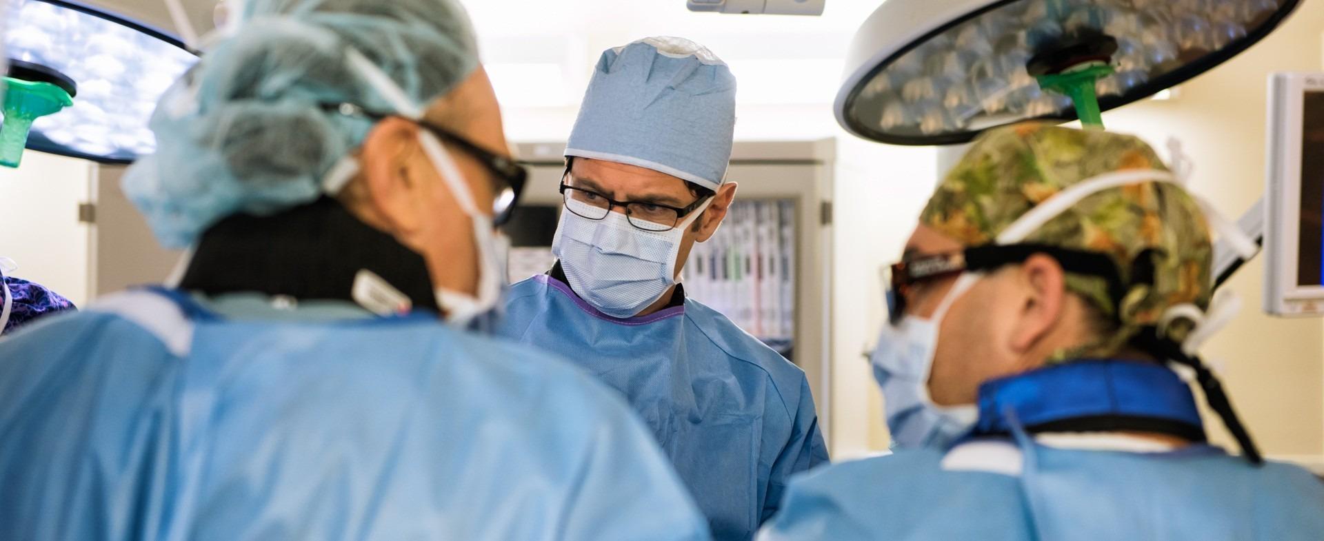 Surgeons discussing procedure