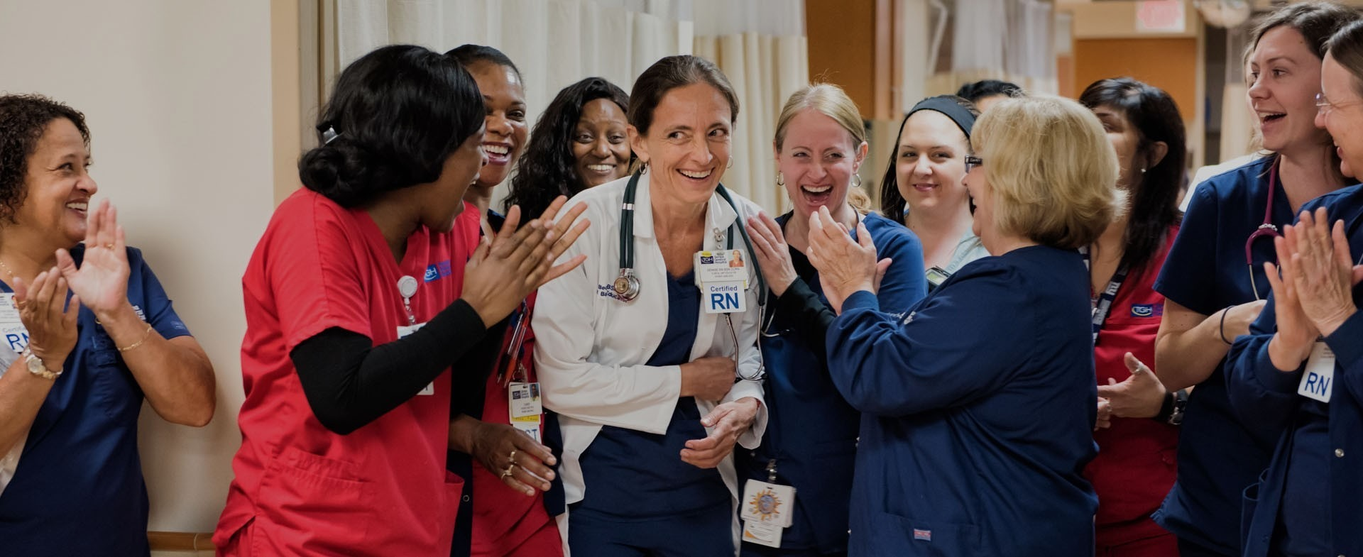A group of nurses smiling and clapping