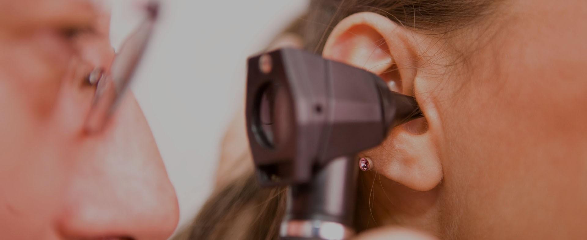 A doctor giving an ear exam