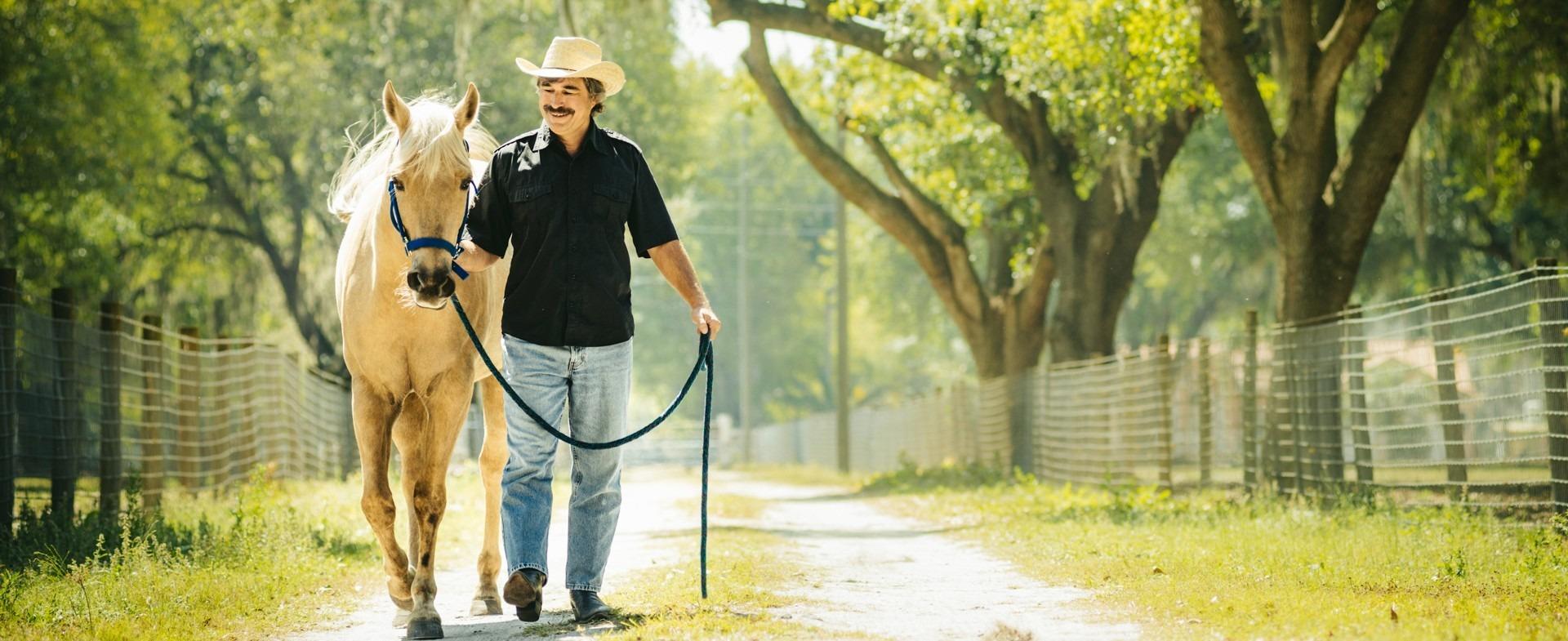 Man walking his horse