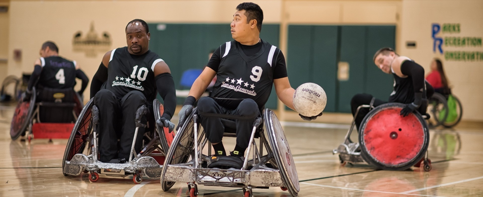 Men playing wheelchair rugby