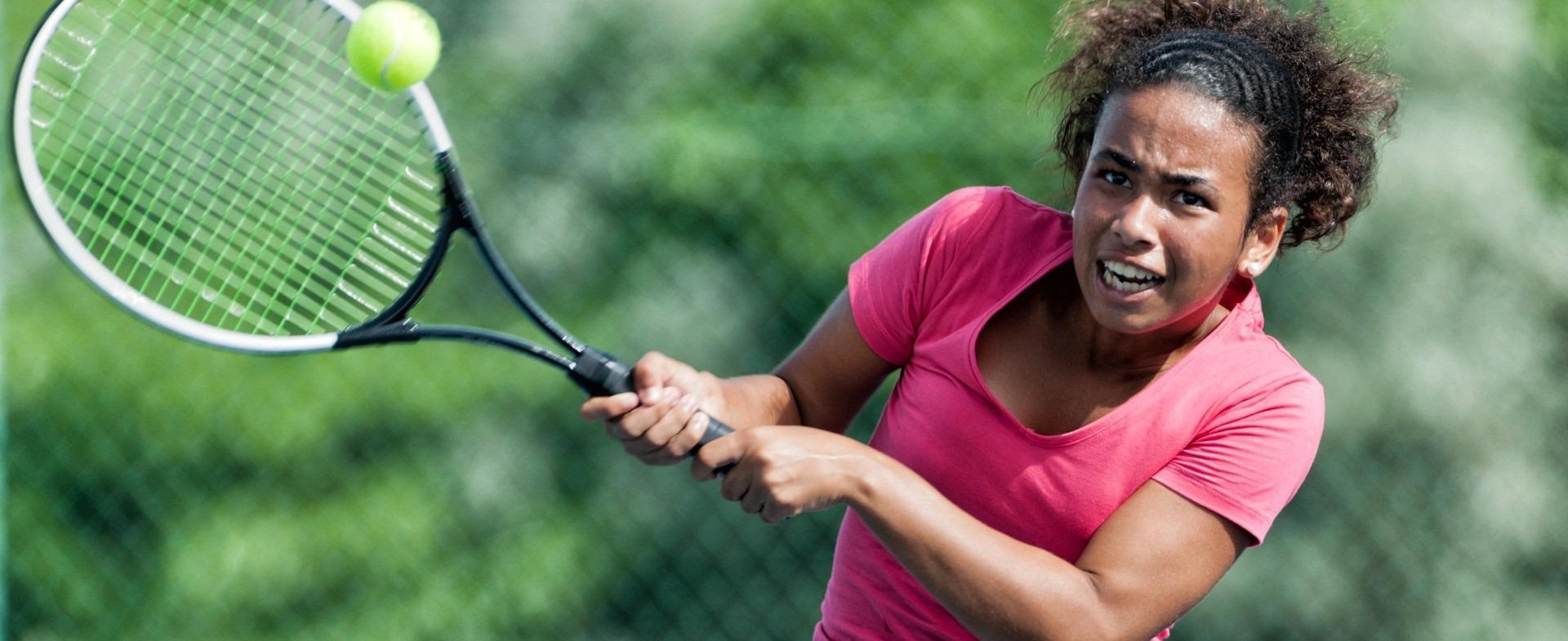 Girl swinging a tennis racket