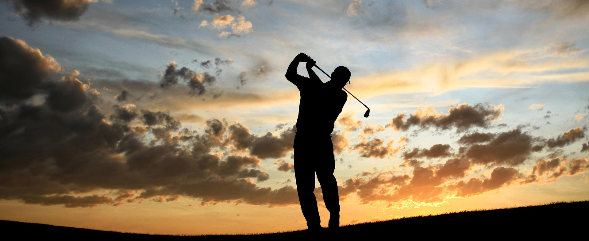 Man swinging a golf club