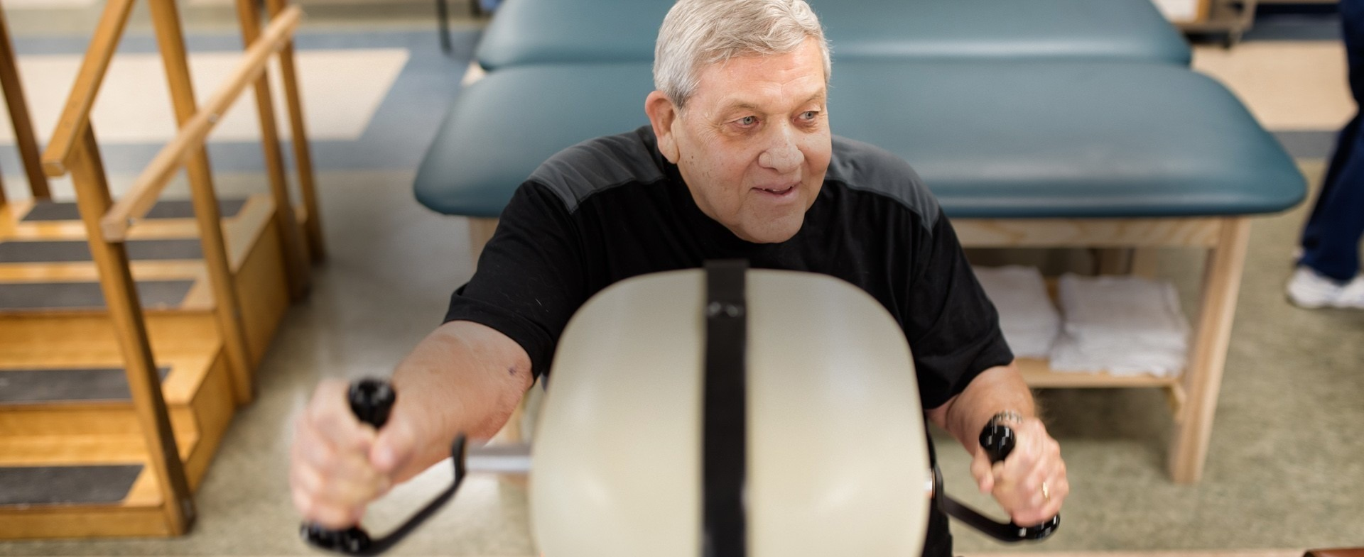 A senior citizen male exercising