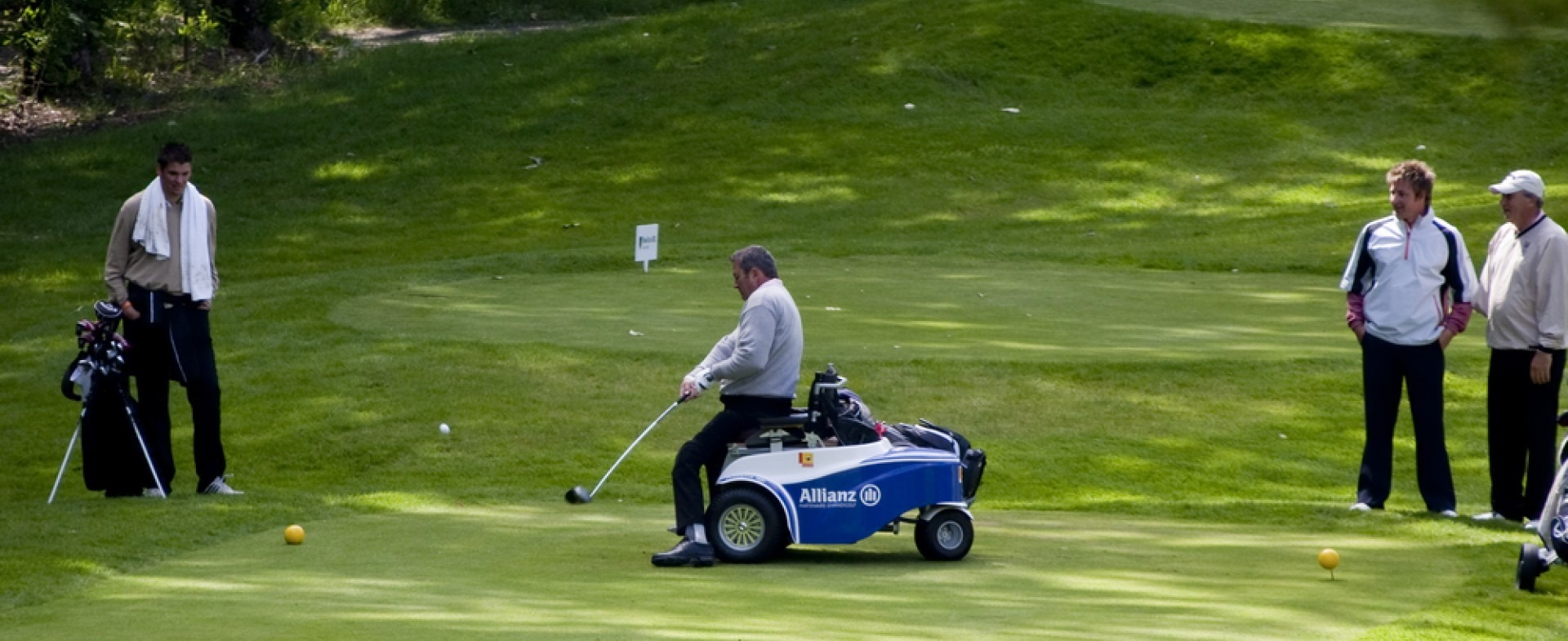 Golfer with a disability using an adaptive golf cart