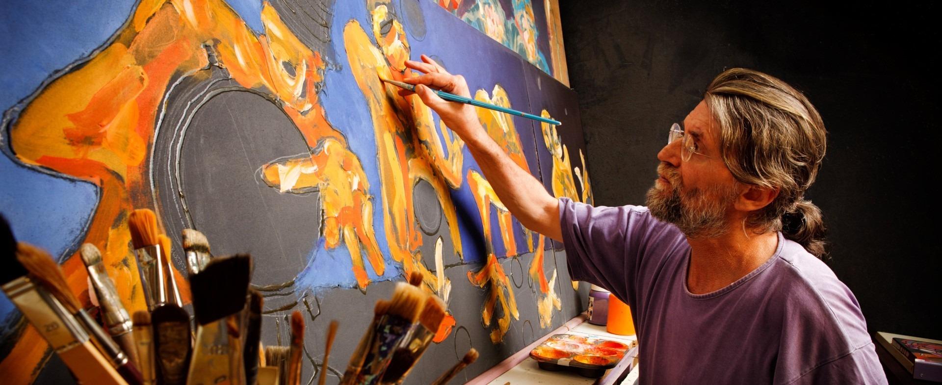 A painter painting a portrait