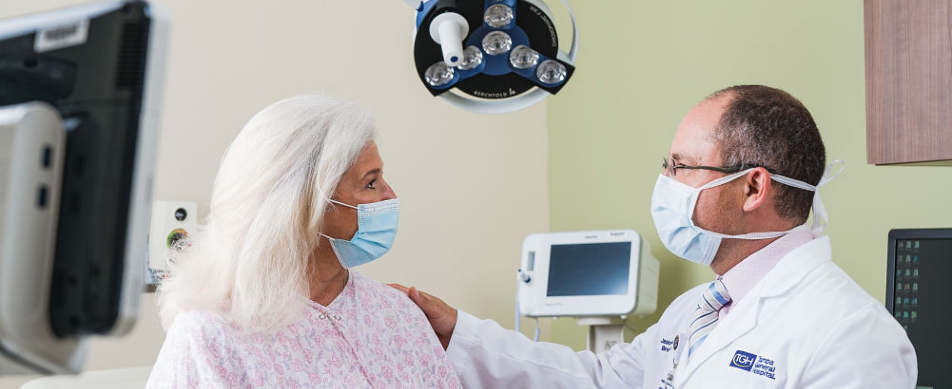 a physician consulting a patient