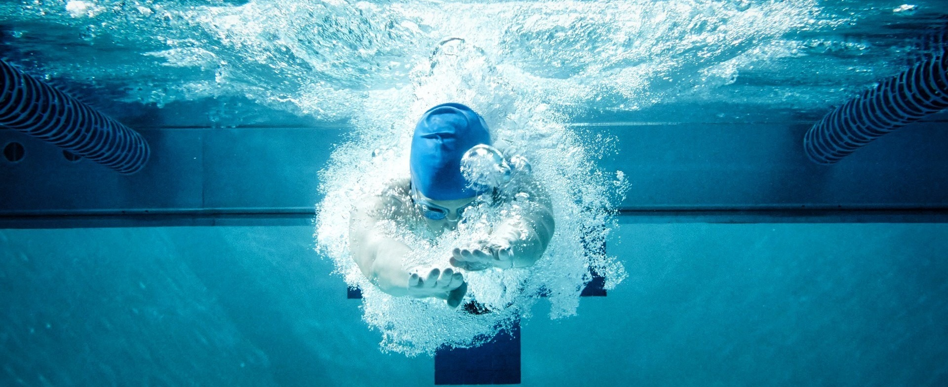 Person swimming in lap pool