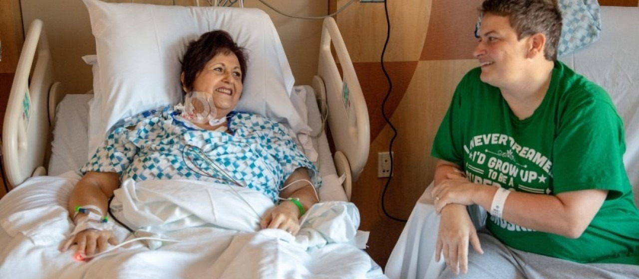 Dr. Melanie Altizer speaks with her friend Marianne McGiffin, a nurse, the day after surgery