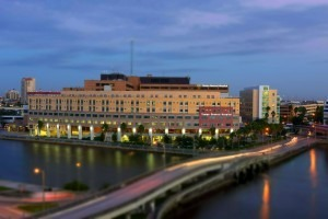 Exterior view of Tampa General Hospital and Davis Island bridge at night