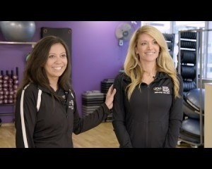 Two female employees in a fitness center