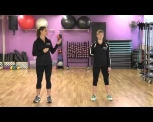 Two women standing in a gym