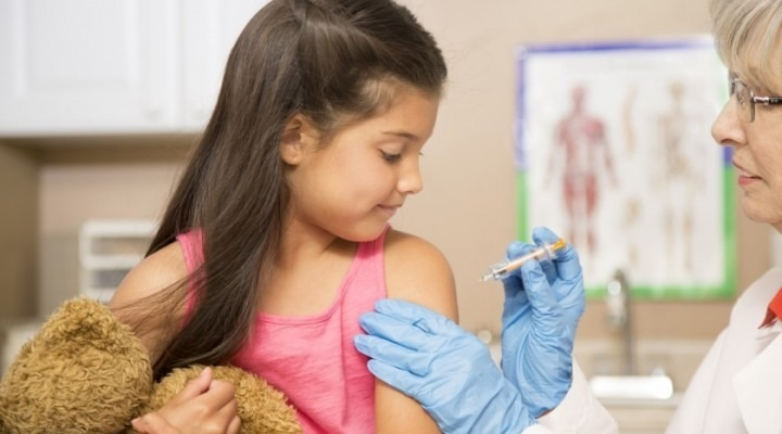 Girl getting flu shot