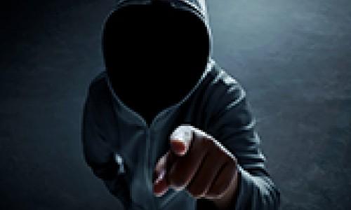 Hacker alone in dark room