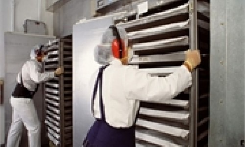 Works put cart in an industrial fridge