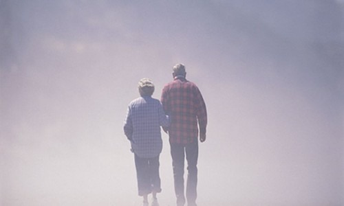 elderly couple surrounded by fog
