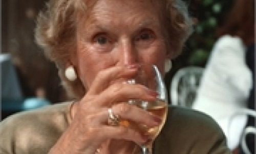 elderly woman drinking wine