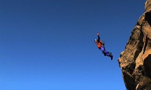 a man cliff jumping