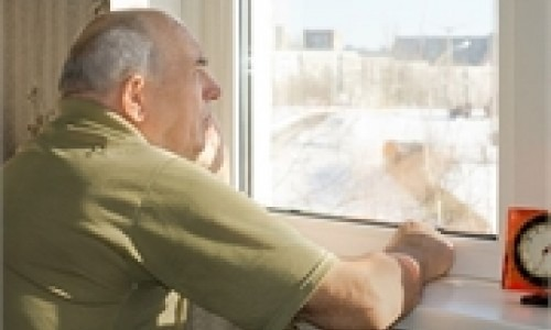 man with alzheimer's stares out of window