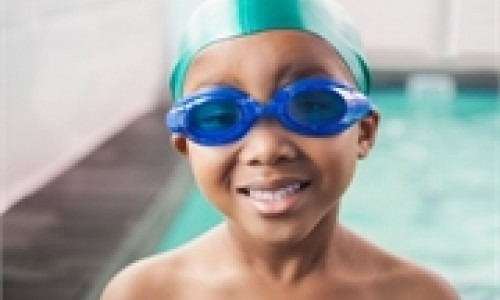 African American boy swimming
