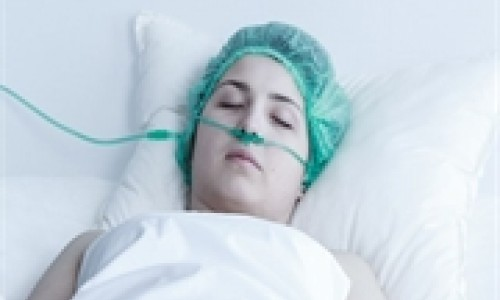 female in coma