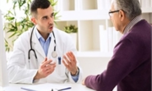 Male physician talking with a male patient