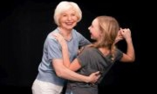 Grandmother and granddaughter dancing