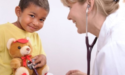 child with teddy bear and nurse