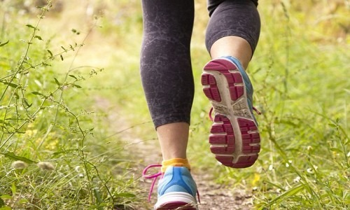 A close up of a woman's legs as she is jogging