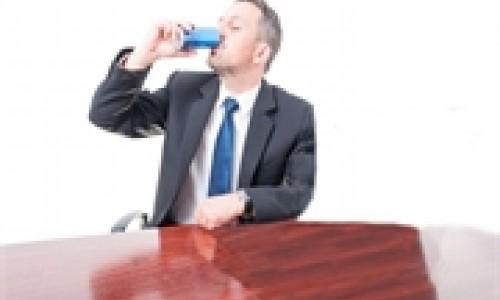 man drinking energy drink