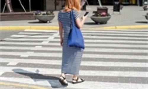 pedestrian with smartphone in crosswalk