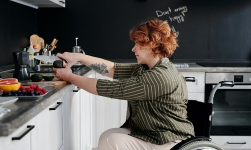 Woman in a wheelchair cooking
