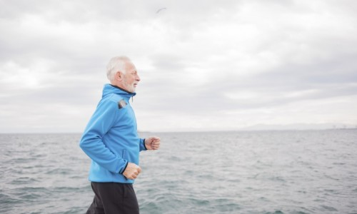 Man running by the sea