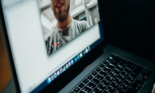Man using video conferencing on a laptop