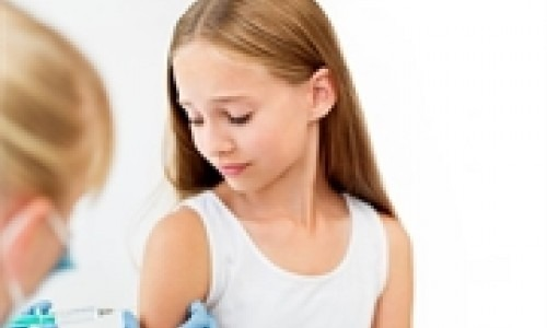 pre-teen girl getting vaccinated