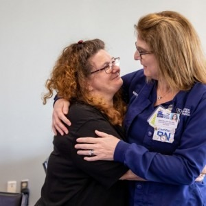 Patient hugs nurse at Trauma Awareness luncheon