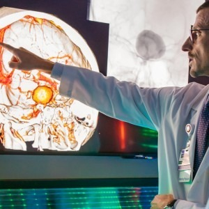 Physicians looking at brain scan