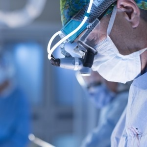 Close up side image of TGH cardiothoracic surgeon during procedure