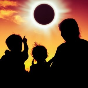 Family watching the solar eclipse