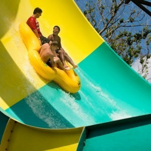 Three boys on a water slide