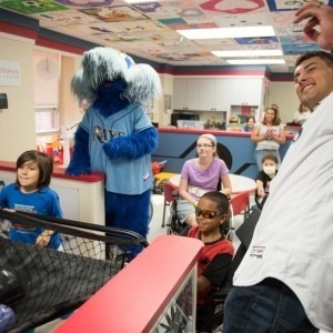 Tampa Bay Rays mascot Raymond and catcher Luke Maile visit patients in the Children's Medical Center at Tampa General Hospital.