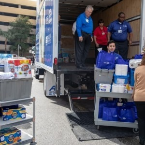 TGH team members load donations onto a truck