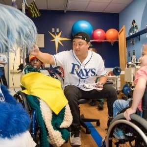 Rays Catcher Hank Conger greets a patient as he visits Tampa General Hospital.