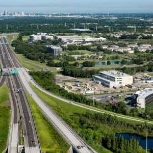 Aerial photograph of the TGH Brandon Healthplex under construction with Tampa in the background.